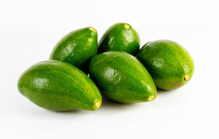 A group of five avocado fruits. Fruits shaped like a pear that can weigh from 100 1,000 g. The skin is green-colored dark and at times dark and almost black purple color, depending of variety and degree of maturity. Your size, although depending of variet