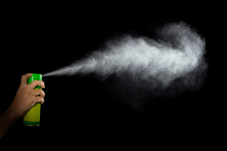 Spray, Pulverized fluid getting out from a container withstood by a human hand Stock Photo