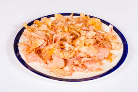 A dish of fried taro slices on a white background