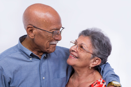 An smiling elderly couple, both wearing glasses. Banco de Imagens - 90695337