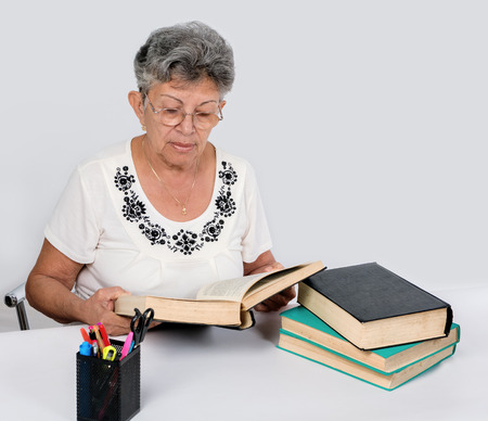 An old woman reading books Stock Photo