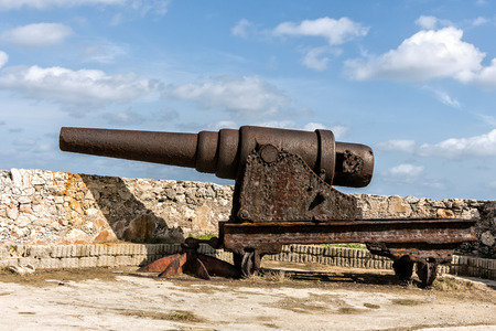 Old and rusty iron cannon