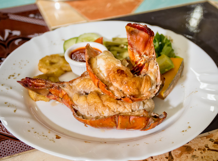 Two middle of a rosted lobster in a white dish Stock Photo