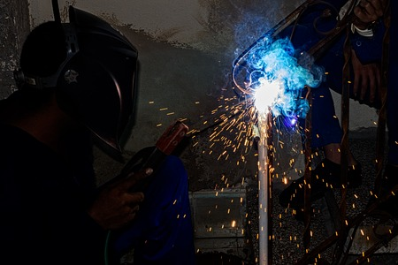 Lights and sparks getting out from welding Stock Photo