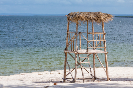 Isolated wood lifegaurd hut in the sand,