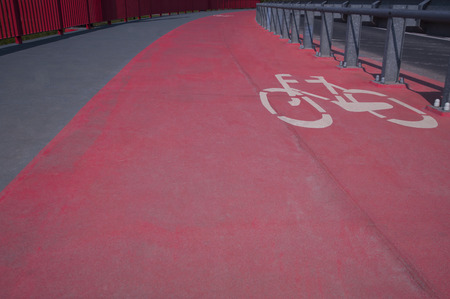 bicycle lane: Red bicycle lane on a gray urban street