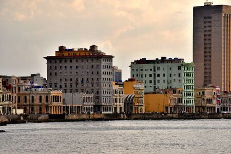beautiful and colorful streets of Havana, 500th anniversary of the foundation of the city. Sunset on the Malecon