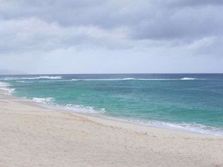 banzai pipeline: Rainy clouds looming over Banzai pipeline Stock Photo