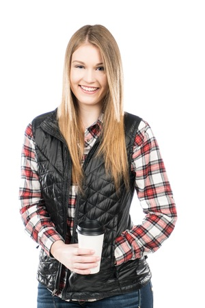Outdoorsy looking girl wearing plaid and jeans holding a paper coffee cup with lid.