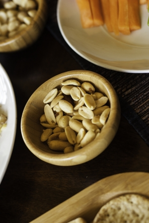 Bowl of salted peanuts served as an appetizer with drinks before a catered meal or at a party Stock Photo
