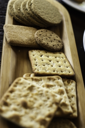 Various biscuits on a wooden plate - selective focus Stock Photo