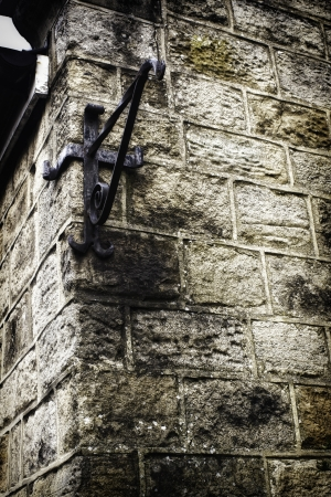 Empty metal angle bracket on the corner of an old grungy stone wall used to mount a sign Stock Photo - 17337705