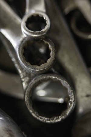 Closeup detail of three worn and well used metal spanners Stock Photo - 17337708