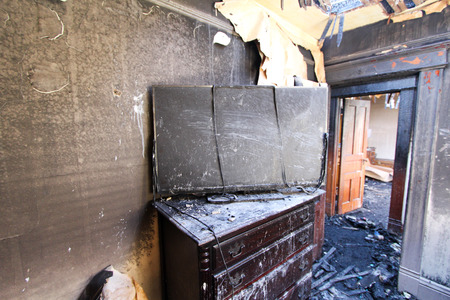 fire damage: Burned TV in Bedroom. Stock Photo