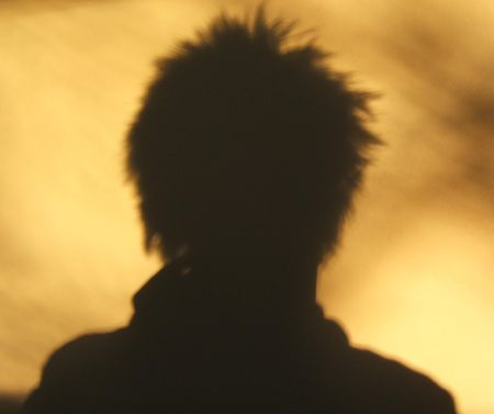 spiky: Spiky hair silhouette off wall