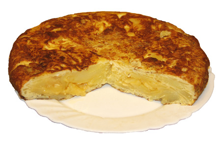 an omelette: Opened potato omelette