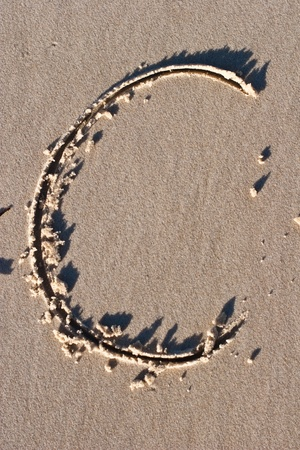 Letter C drawn in the Sand photo