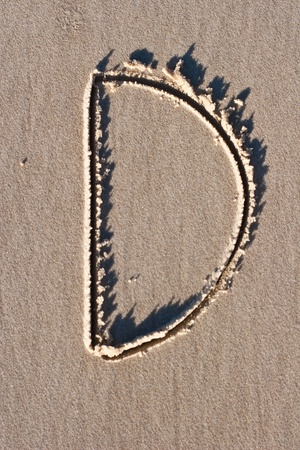 Letter D drawn in the sand.  Stock Photo - 8816491