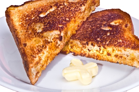 Beautifully toasted bread with butter.  Stock Photo