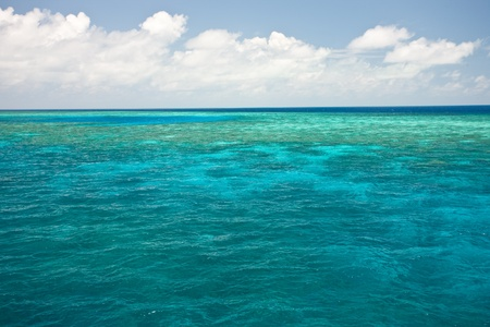 Ocean blue water with reef in the distance.  Stock Photo - 8816534