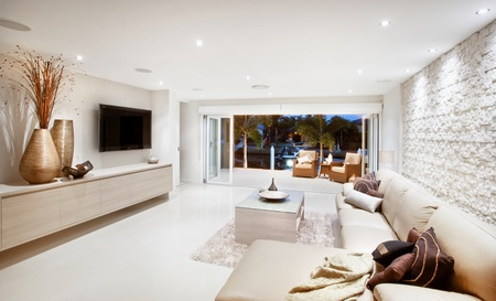 accents: Stark white contemporary livingroom with few color accents Stock Photo
