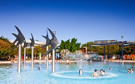 People swimming amongst the Fish Sculptures at the swimming lagoon in Cairns, Queensland, Australia