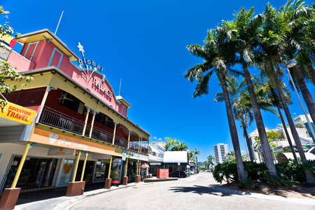 cairns: Street scene in Cairns, Australia with old colonial architecture and tropical palm trees