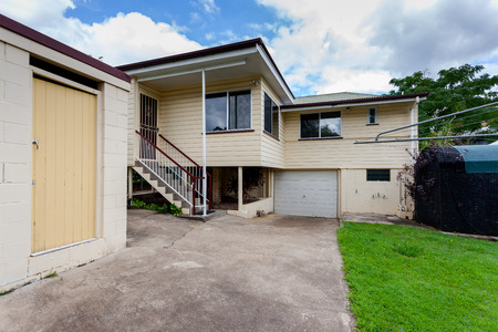 two floors: Garage and a backyard of a small house with two floors