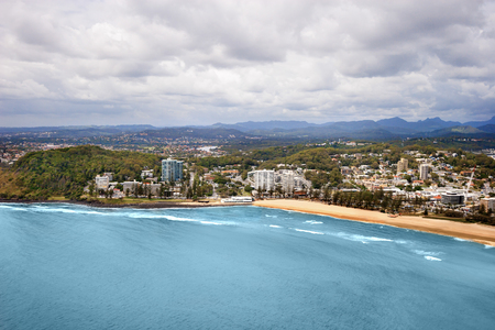 moutains: Picture of a big city located on a coast, taken on a cloudy day with moutains seen in the horizon, surfers paradise Stock Photo