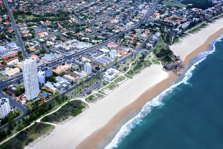 surfers paradise: Aerial shot of a huge city located in front of a coast; many buildings and streets can be seen, surfers paradise