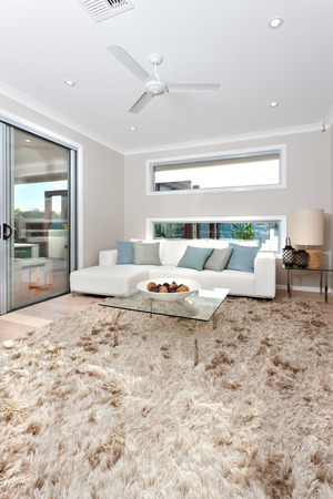 ceiling fan: The room has a glass door  and a long windows fixed to walls