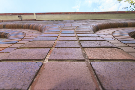 first plane: a looking-up shot of a wall of the brick great house Stock Photo