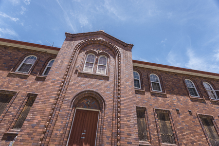 side shot: a side shot from a facade of a brick mansion