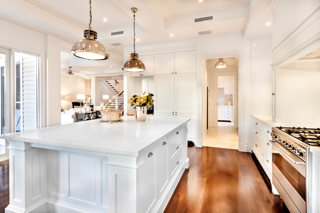 Beautiful kitchen having electrical automatic cooking gas and fruits, flowers kept on table