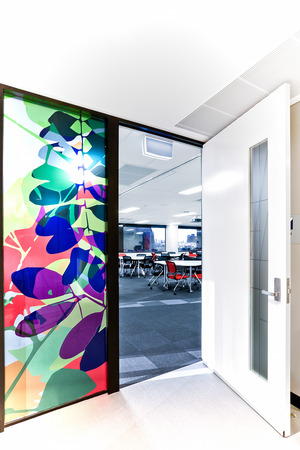 high angles: High angles of room entrance with white walls and windows in a modern building with door post and colorful deign