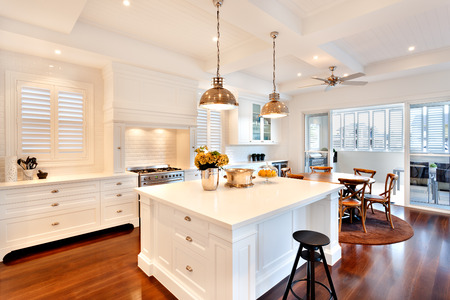 kitchen counter top: Attractive and beautiful kitchen having glossy wooden floor of a luxury house