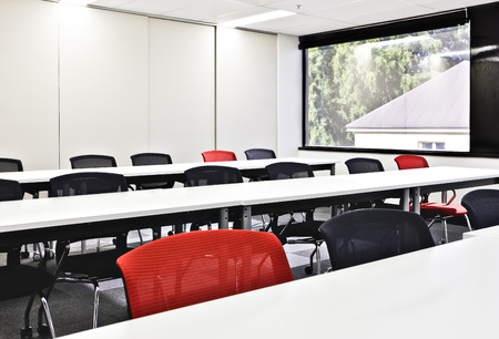 architectural firm: Closeup of chairs and tables in a conference room with glass windows  and white walls Stock Photo