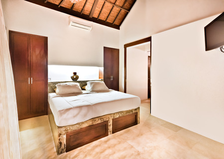 cupboards: Old looking bedroom decorated with wooden showing inside illuminated with bed and cupboards