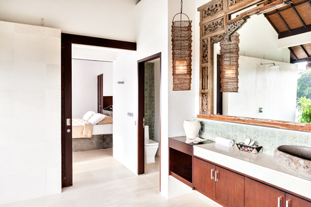 seminyak: Outside washing area with the toilet and bedroom attached closely and exposed to the outside in a modern house