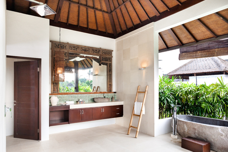 stone wash: Bathing area from the outside with the wash area that covered with plants, stone or cement basin, tub to shower