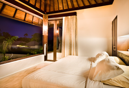 interior walls: Outdoor bedroom at night with lights on and outside can be through the window at night Stock Photo