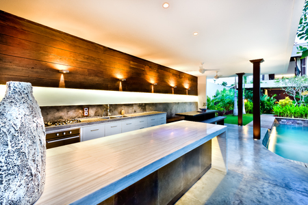 seminyak: Outside cooking and flashing light area with a pool beside a garden of a modern house