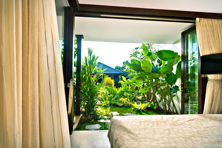 seminyak: Outside view of garden  from the inside of the bedroom of a modern house