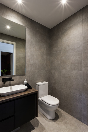 bowl sink: Modern bathroom including black color faucet and sink with a mirror next to the toilet bowl