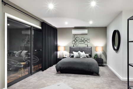 Black color bed in luxurious hotel or house  with flashing lamps beside a glass door or window Banco de Imagens