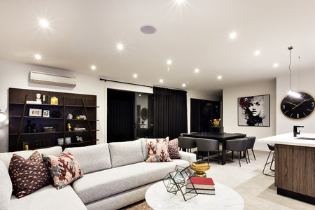 Modern house interior with sofas and tables based shelf with fancy and antique items