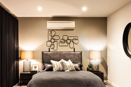 table lamps: Modern bedroom included flashing table lamps with air conditioner in a luxury house