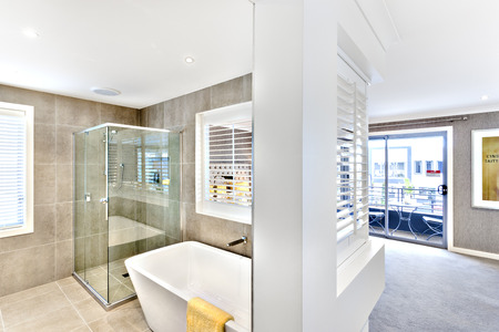 Modern washroom attached to the hallway to the outside windows or door which spreading sunlight, the bathroom included a shower and washbasin 新聞圖片