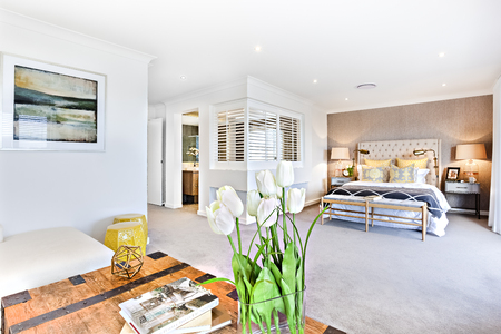 wooden partition: Modern living room and bedroom with a hallway to the inside of the house with a room partition, there is a wooden table focusing a white rose flowering plant on it as a closeup view