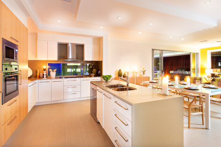 roomy: Roomy interior has illuminated with yellow light spreading over the whole kitchen and dining area, The flashing candles on the center of the kitchen and top of the table giving an extra shiny look to the area